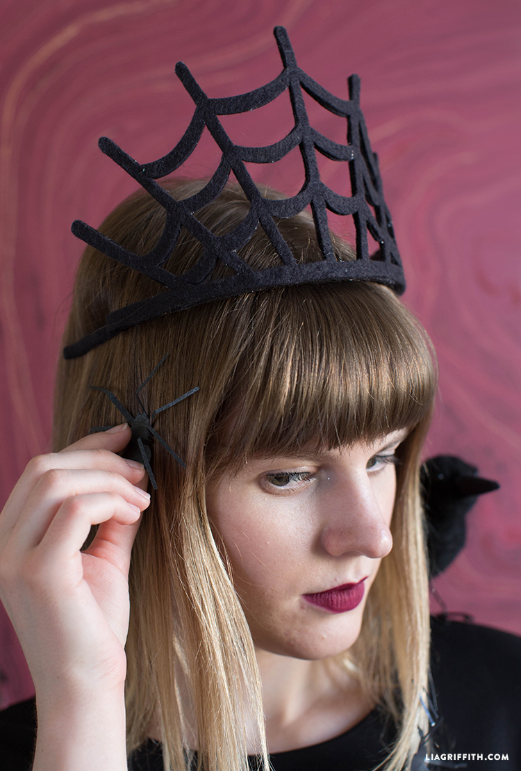 Woman wearing spiderweb crown for Halloween