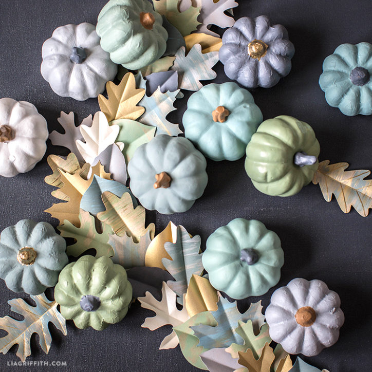 painted mini pumpkins and painted paper leaf garland