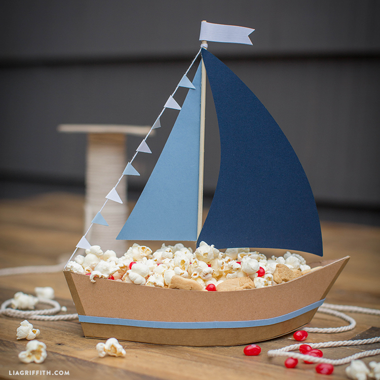 Ship Party Snacks with This DIY Paper Sailboat Centerpiece!