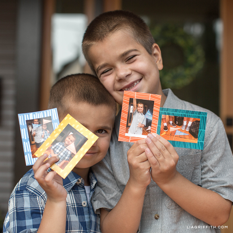 Boys holding printed school photos from Canon IVY Mini Photo Printer