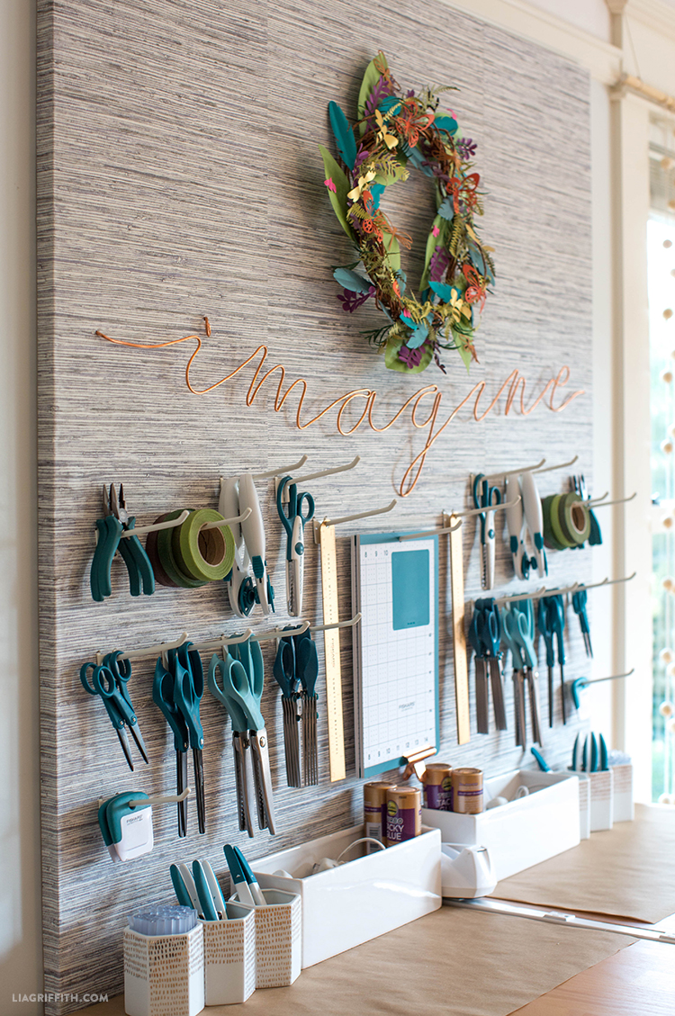 "Copper wire ""imagine"" on DIY pegboard with craft tools"