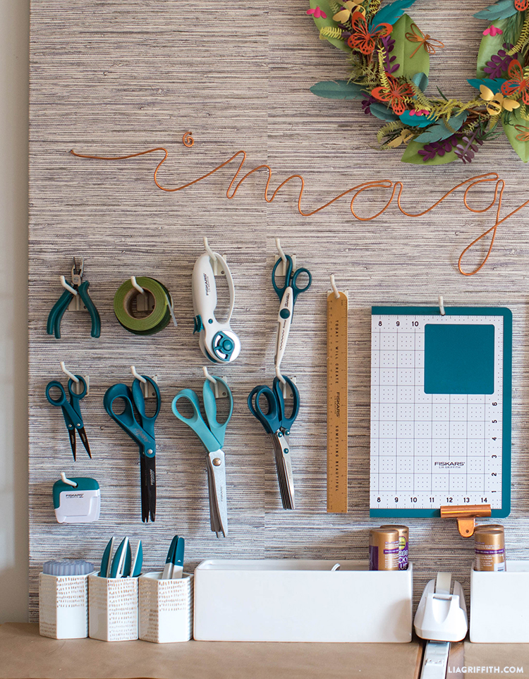 Lower left side of DIY pegboard with craft tools