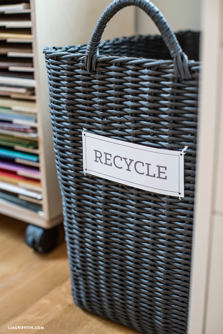 """Recycle"" label on wicker basket"