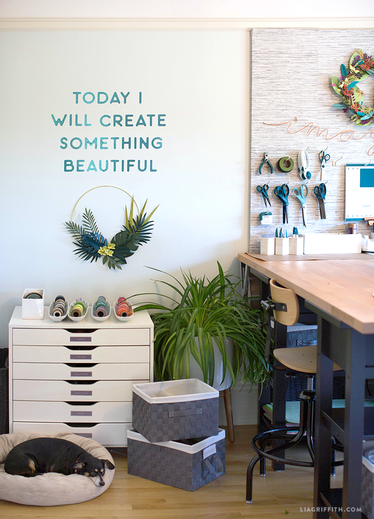 """Today I will create something beautiful"" vinyl decal on craft room wall with dog"