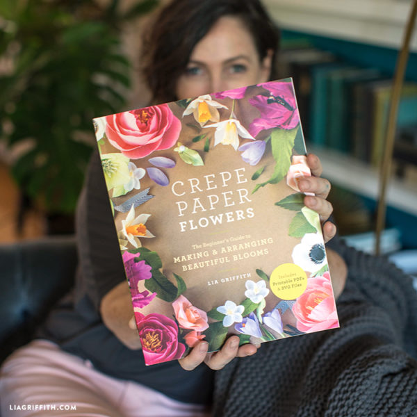 Lia Griffith holding Crepe Paper Flowers book