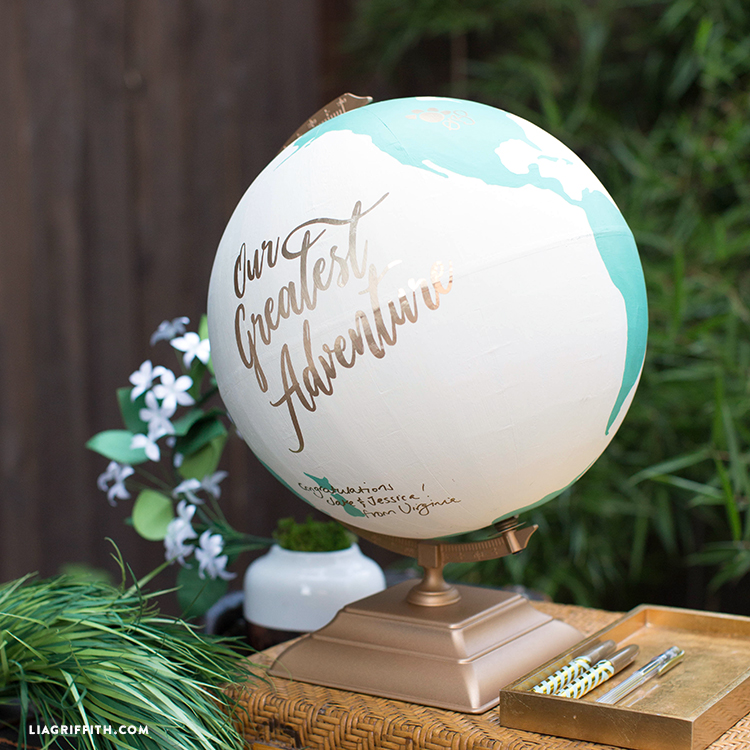 Globe guest book that says congratulations