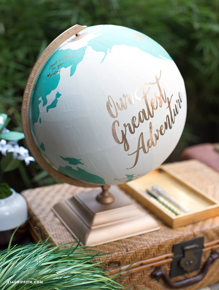 Globe guest book on suitcase with pens