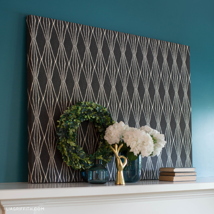 DIY fabric canvas art on mantel with home decor