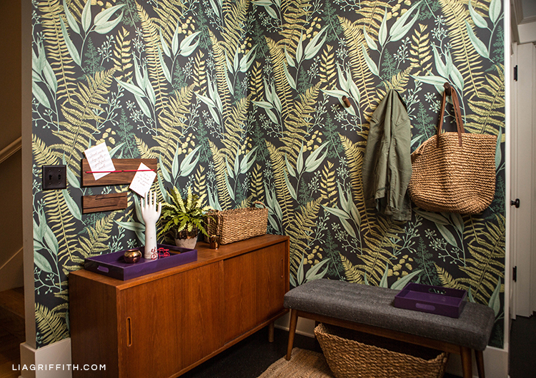 Fern wallpaper with entryway furniture and decor