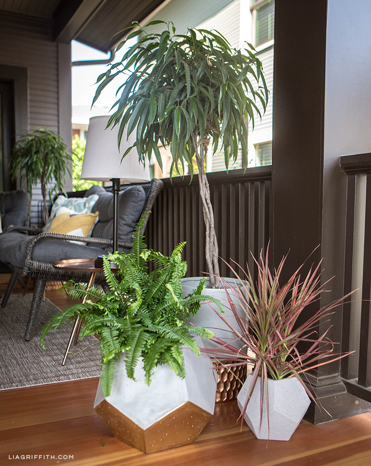Hayneedle textured planter and geometric planters on front porch