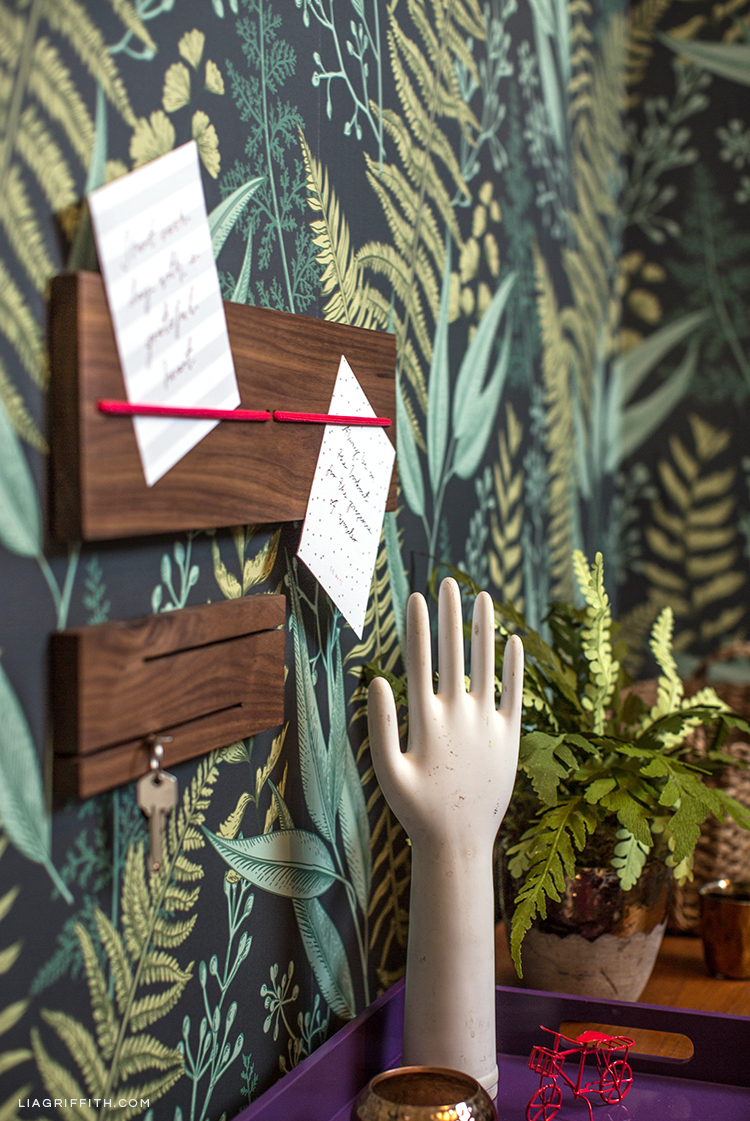 Loma Living note board and key station above DIY entryway ideas
