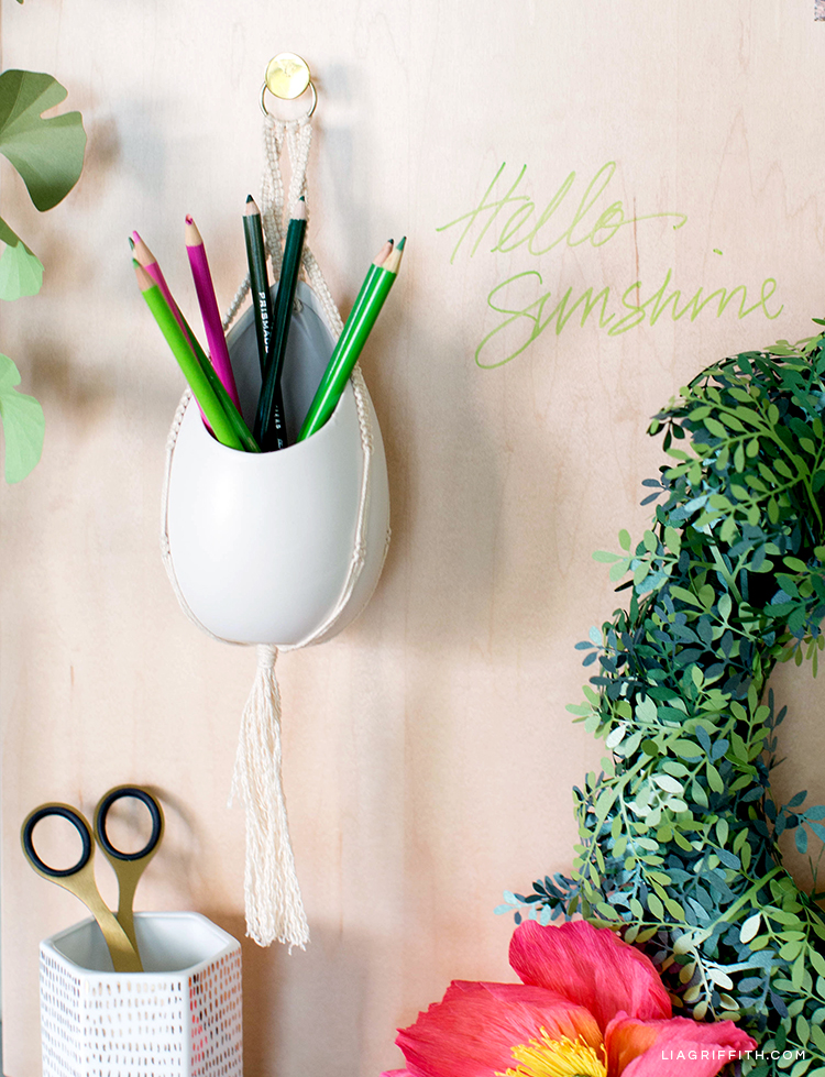 DIY macrame pencil holder on wood dry erase board