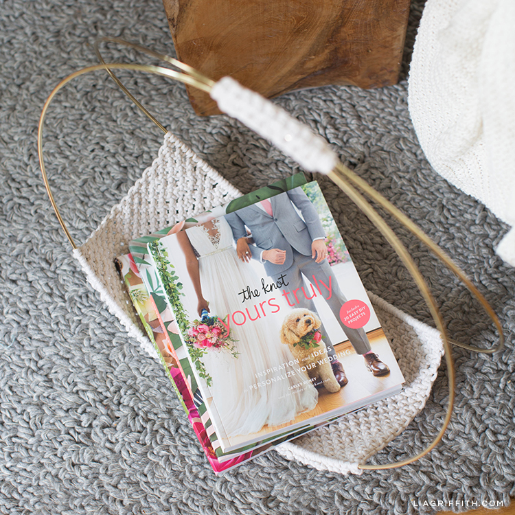 Close-up of macrame magazine holder with magazines