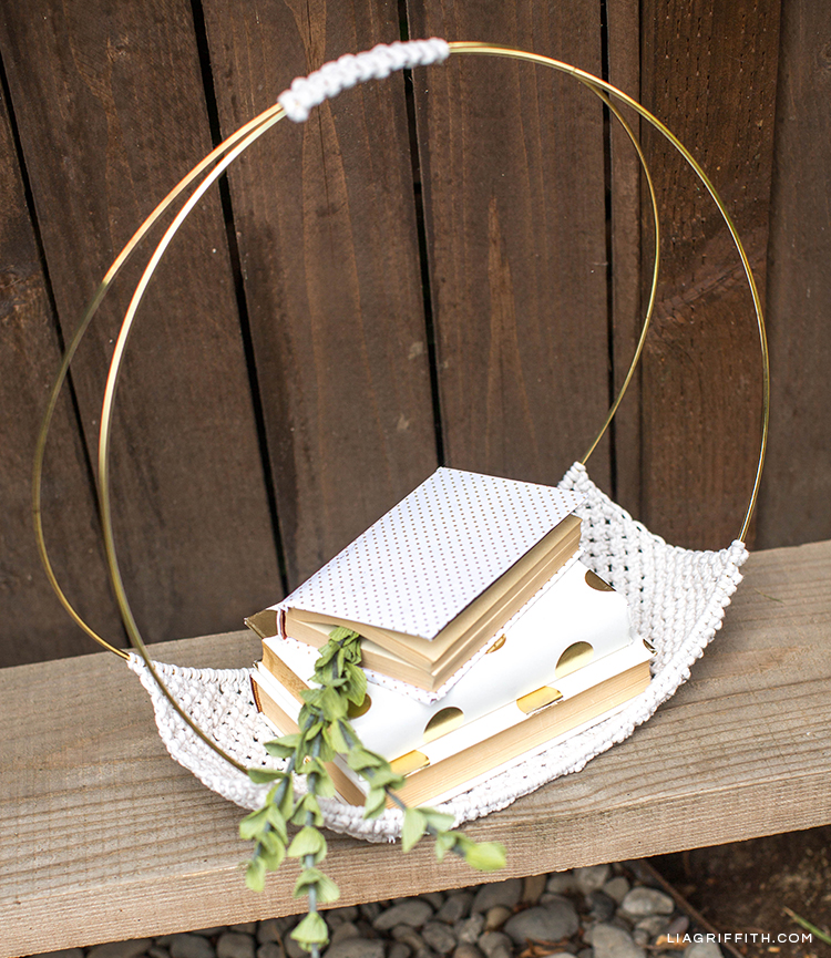Macrame magazine holder on bench with books