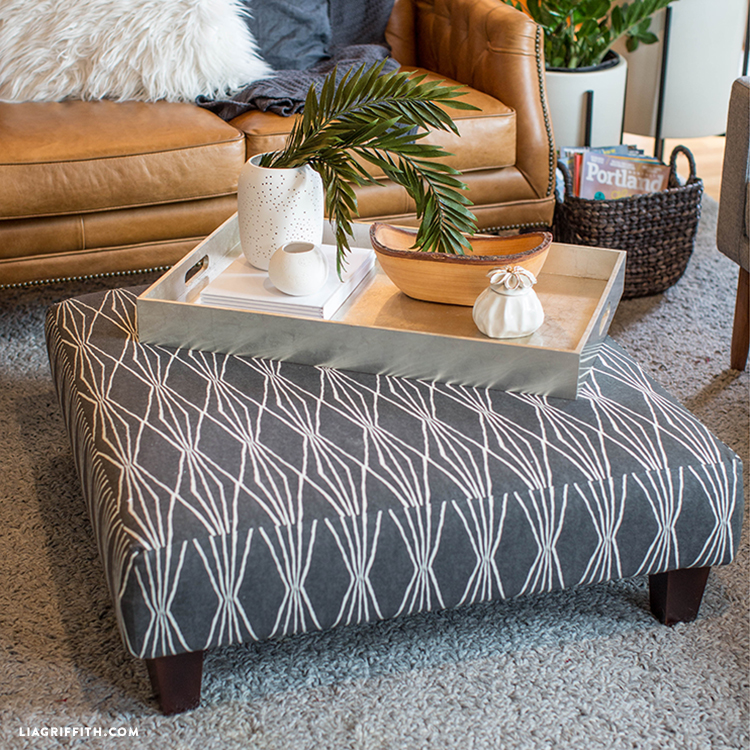 Updated ottoman with tray next to couch