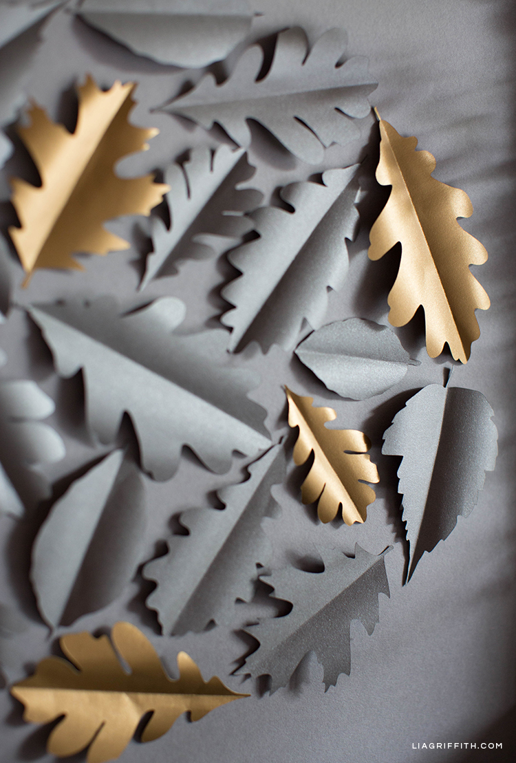 Grey and gold paper leaves on framed art