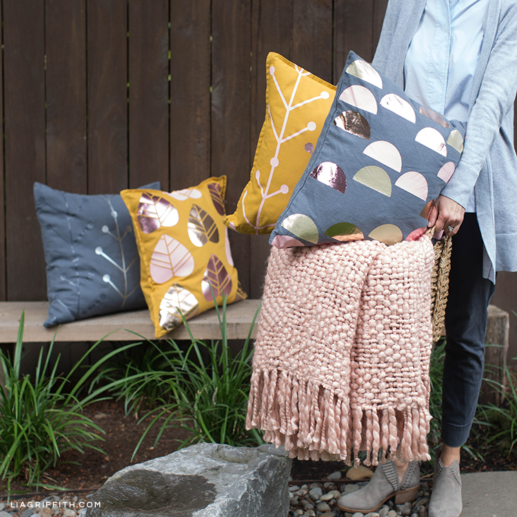 Person holding blanket and Scandi style pillow
