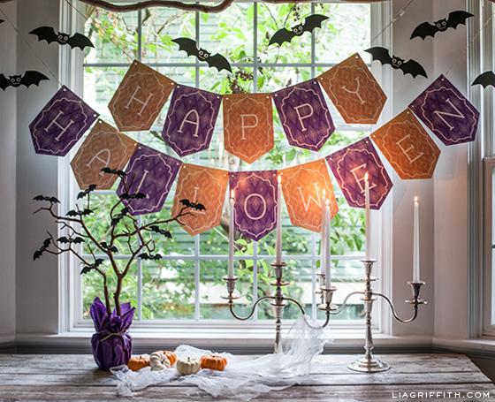 Happy Halloween banner and decorative bats