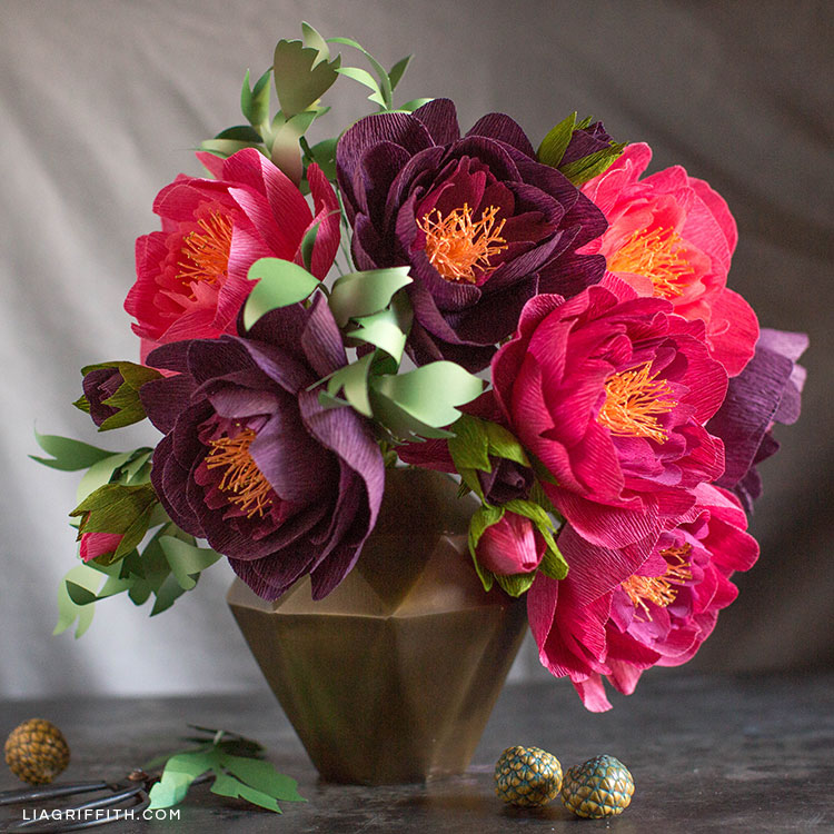 crepe paper peonies in fall colors in gold vase