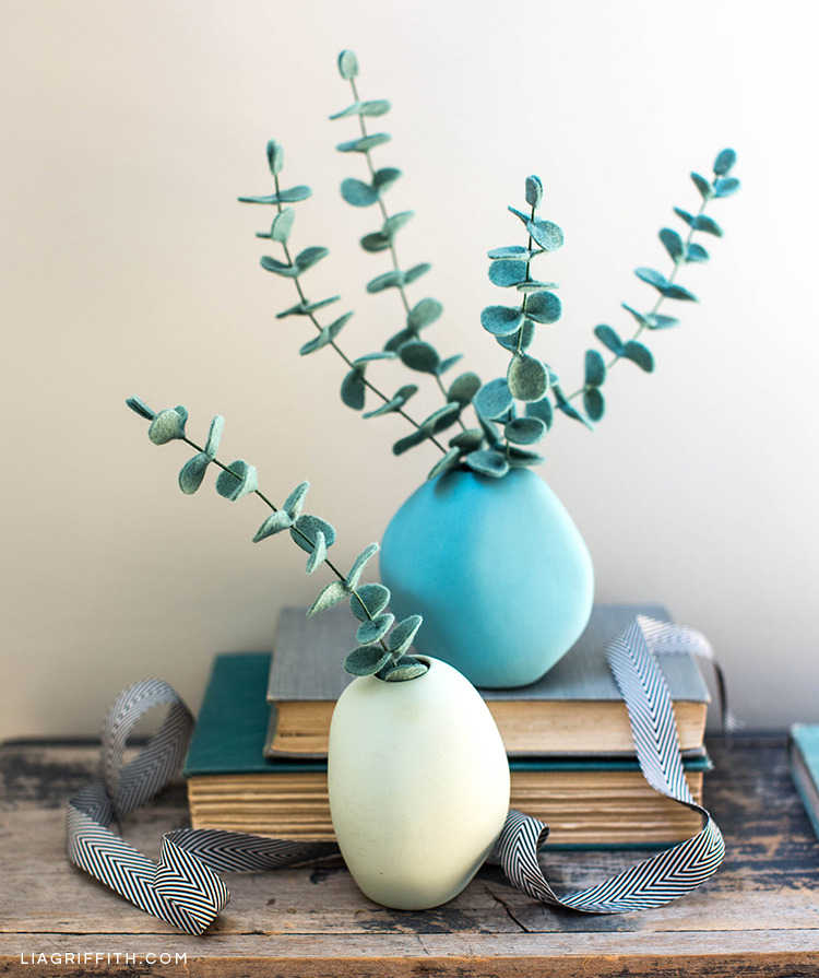 Baby blue eucalyptus plants in vases