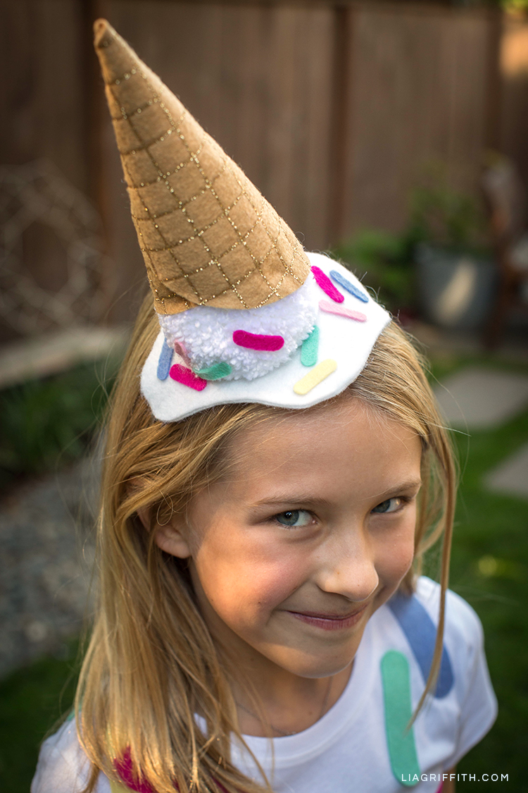 Girl wearing DIY ice cream cone costume