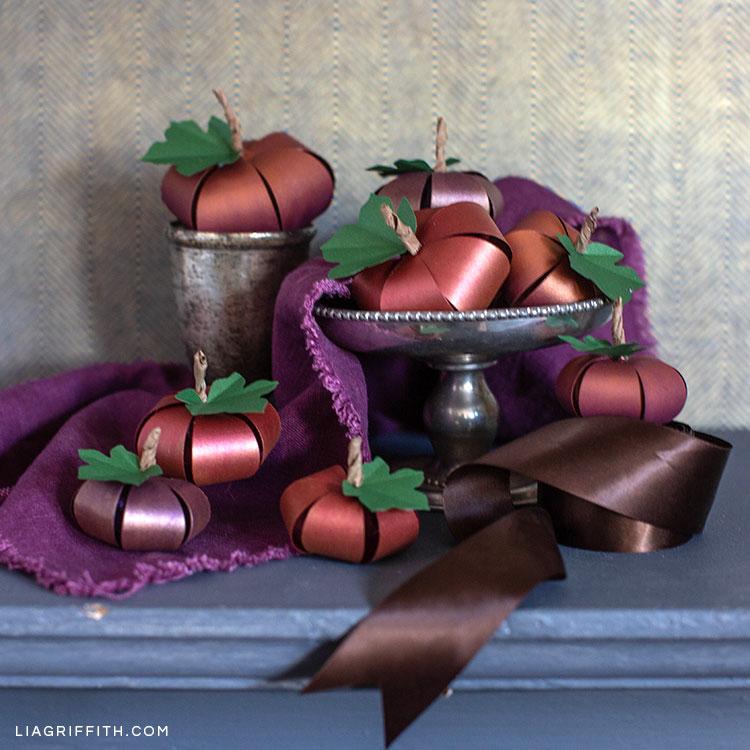 ombré paper pumpkins on mantle