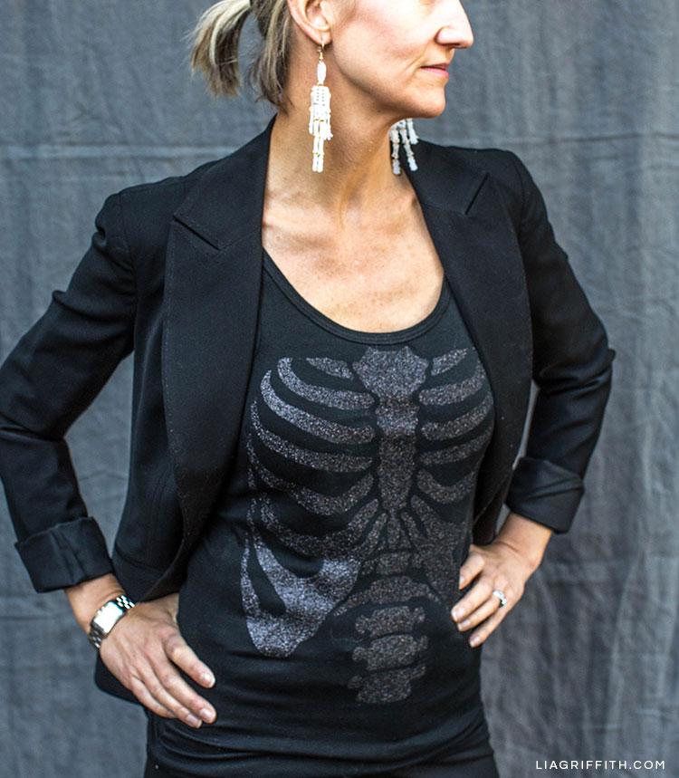Woman wearing DIY skeleton top and DIY skeleton earrings