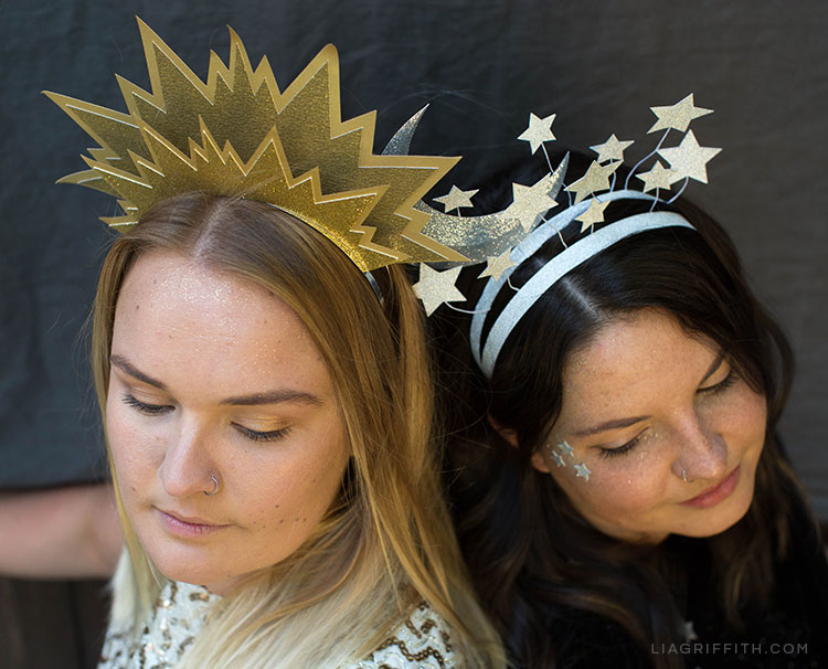 Two women wearing DIY sun and moon headbands for Halloween
