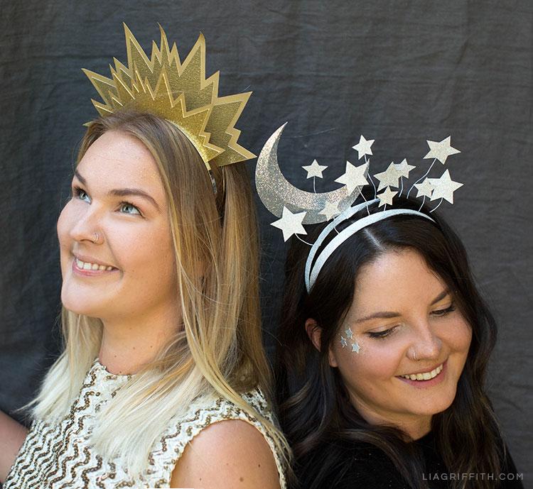 Two women wearing DIY sun and moon headbands for Halloween