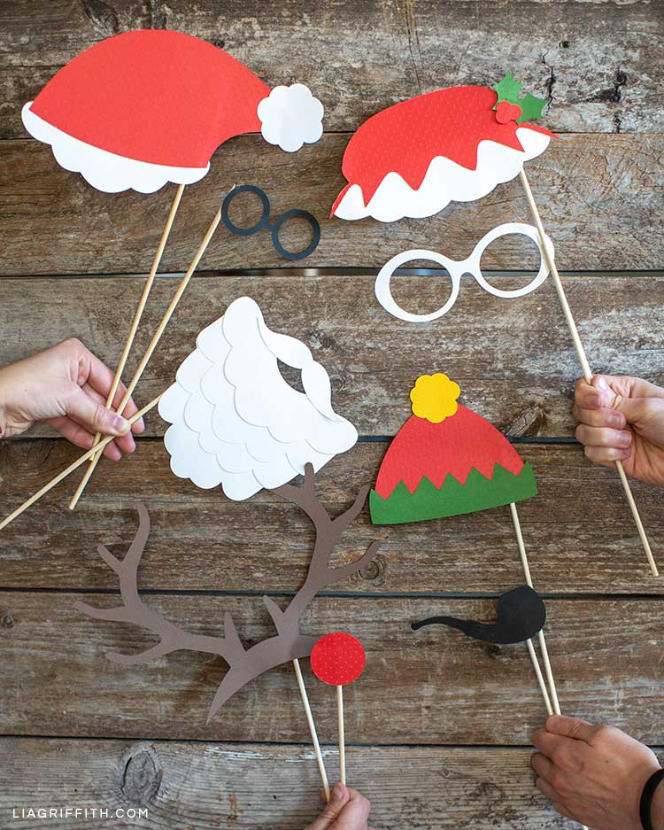 hands holding Christmas photo booth props