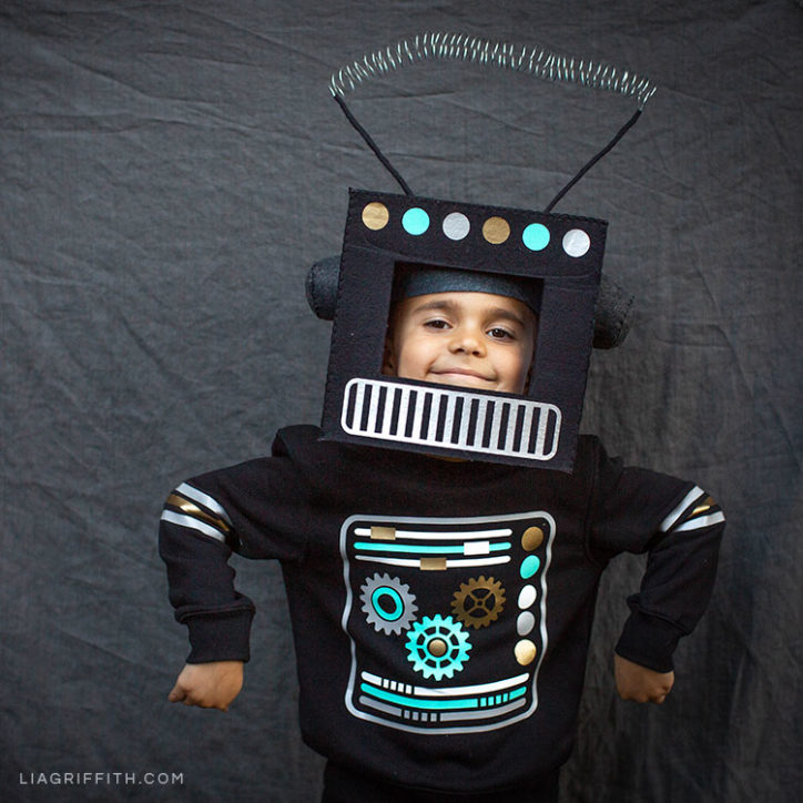 Boy wearing DIY robot costume for Halloween