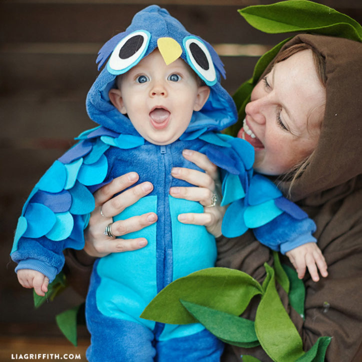 Mom in DIY tree costume holding baby in DIY owl baby Halloween costume