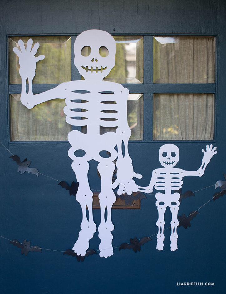 Jumbo Mr. Paper Bones skeleton on front door for Halloween