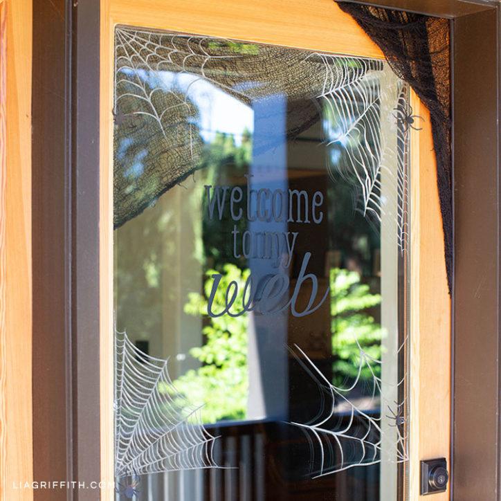 spiderweb window clings on door for Halloween