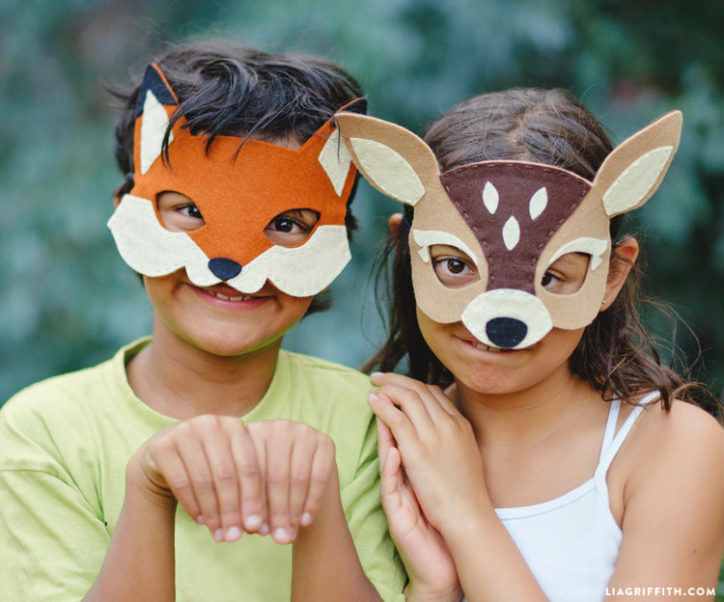 Kids wearing DIY woodland masks for Halloween