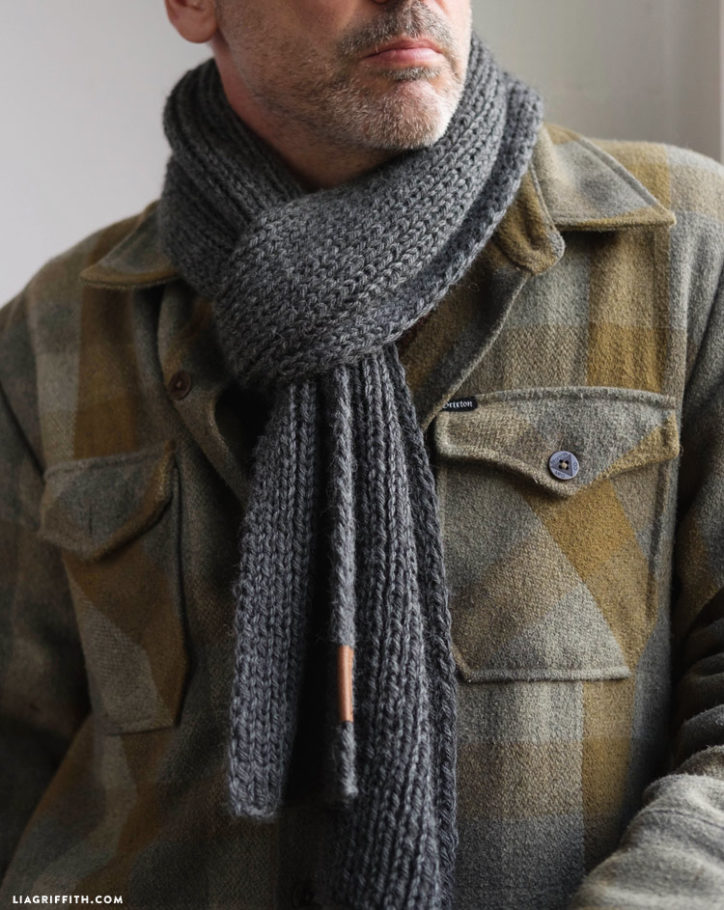Man wearing wool knit scarf