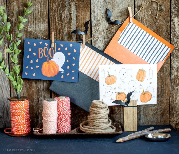 free printable Halloween cards hanging up outside next to twine