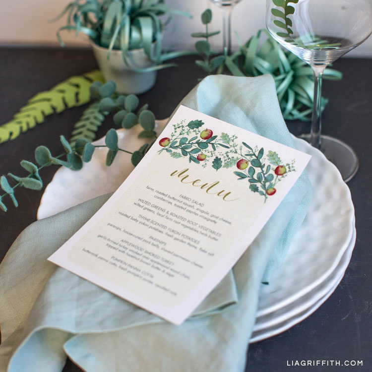 Thanksgiving dinner menus on table settings with felt eucalyptus and paper air plants