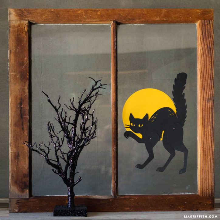 Paper black cat and full moon for window Halloween decorations