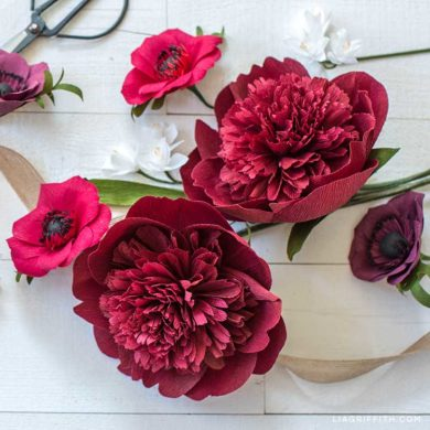 crepe paper red charm peony flowers with paper anemones and paperwhites