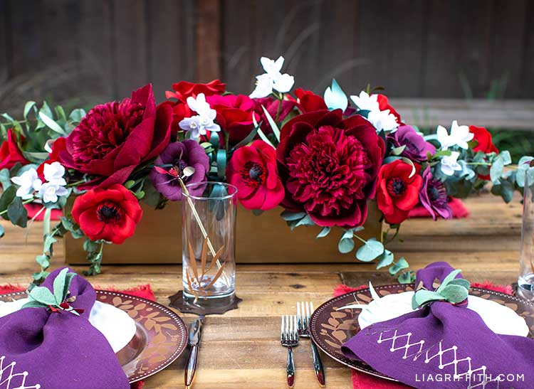 crepe paper red charm peony in floral centerpiece on holiday table with DIY place settings