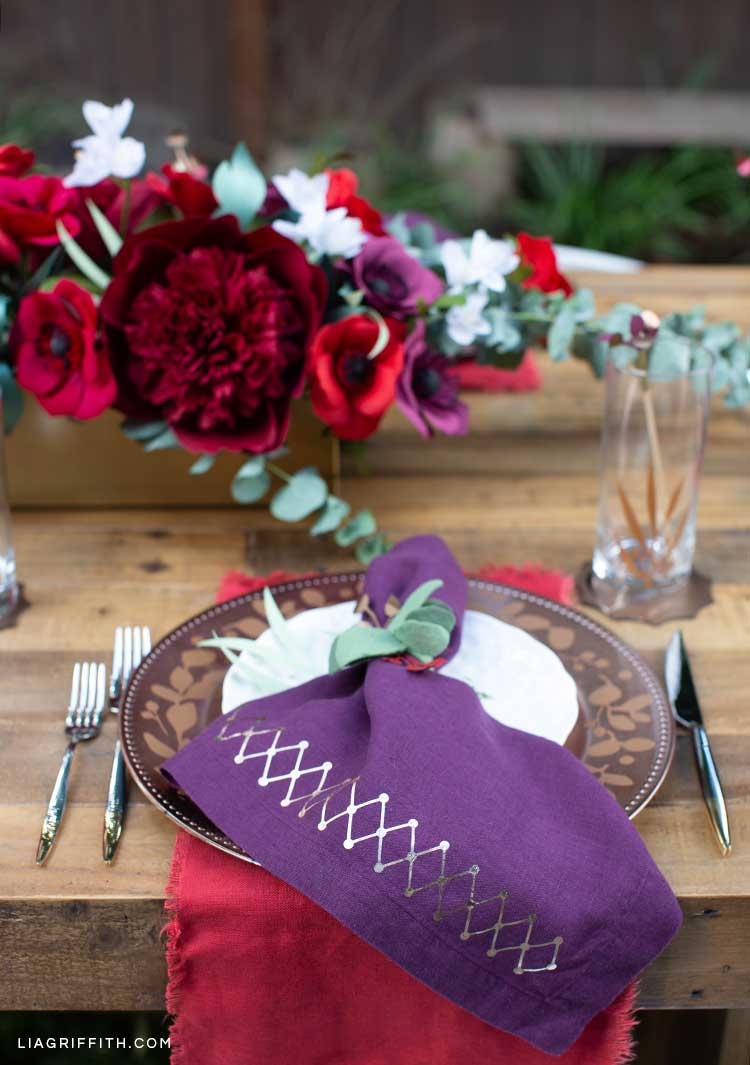 DIY place settings in front of floral arrangement on table