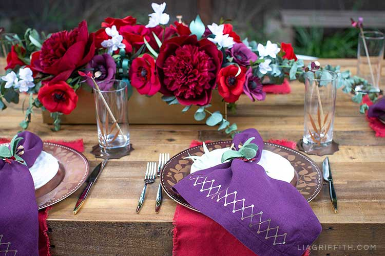 DIY place settings and paper flower centerpiece for holiday tablescape