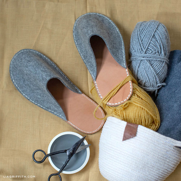 DIY felt and leather slippers next to yarn