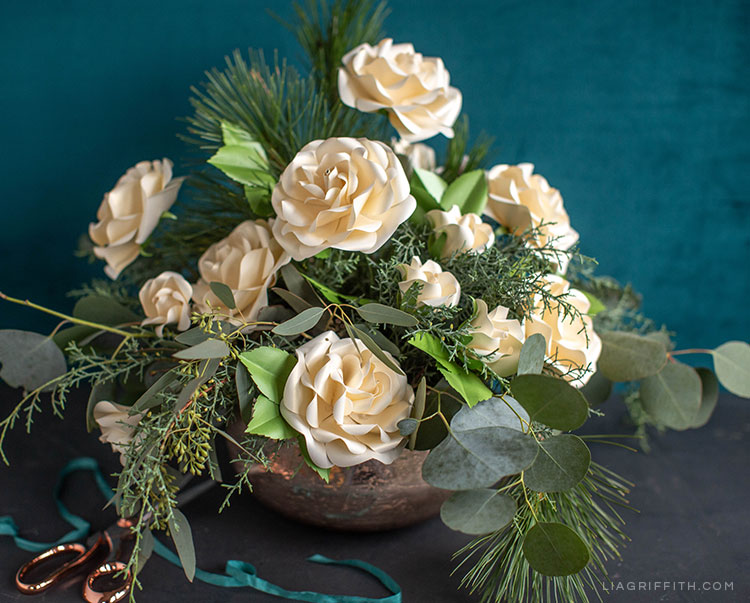 pearly frosted paper Ecuadorian roses and fresh greenery arrangement