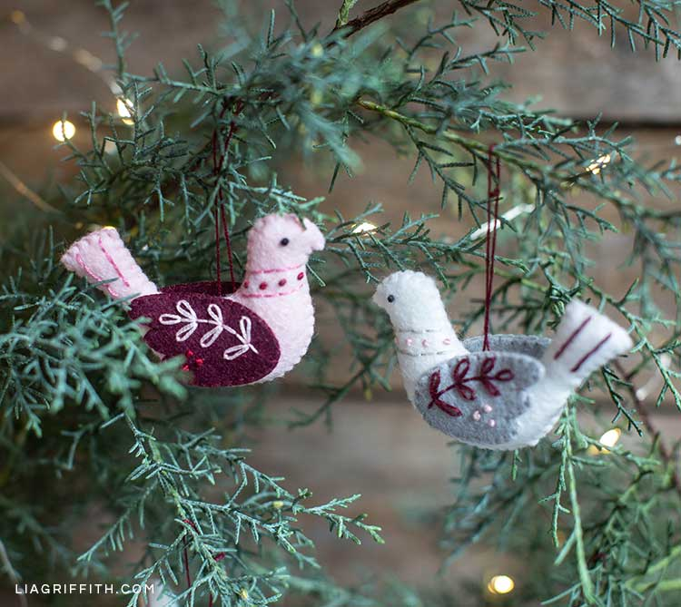 embroidered felt bird ornaments hanging on tree