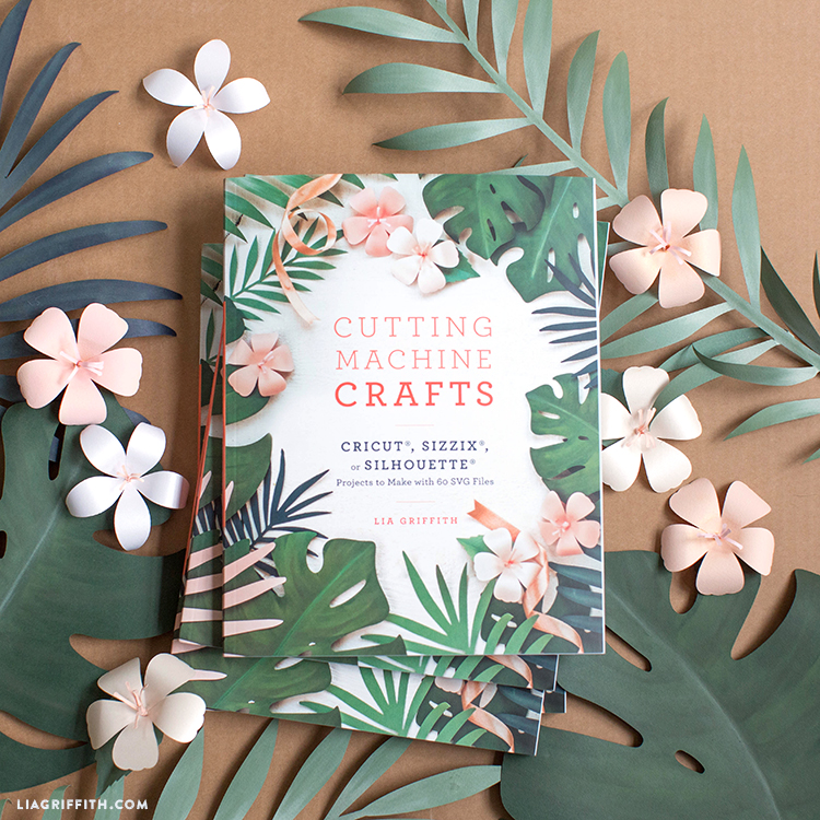 Cutting Machine Crafts book by Lia Griffith on top of paper leaves and flowers