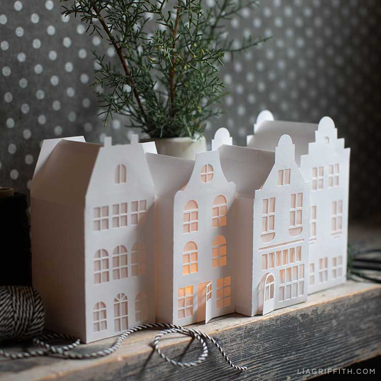 paper canal houses on mantel with fresh greenery