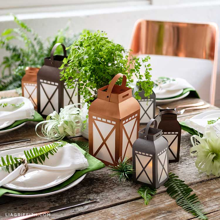 DIY paper garden lanterns on table with place settings and plants