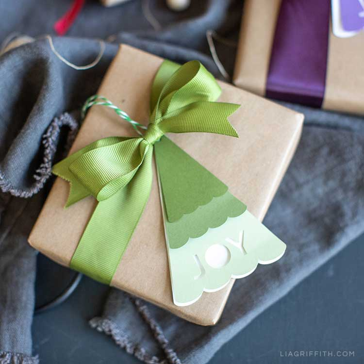Christmas tree gift tag with the word joy on it